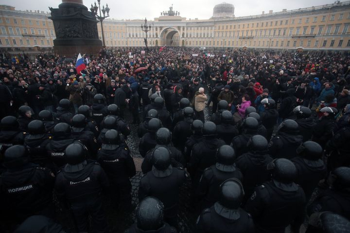 Russian riot police face protesters demonstrating against Russian Prime Minister Dmitry Medvedev in St. Petersburg,
