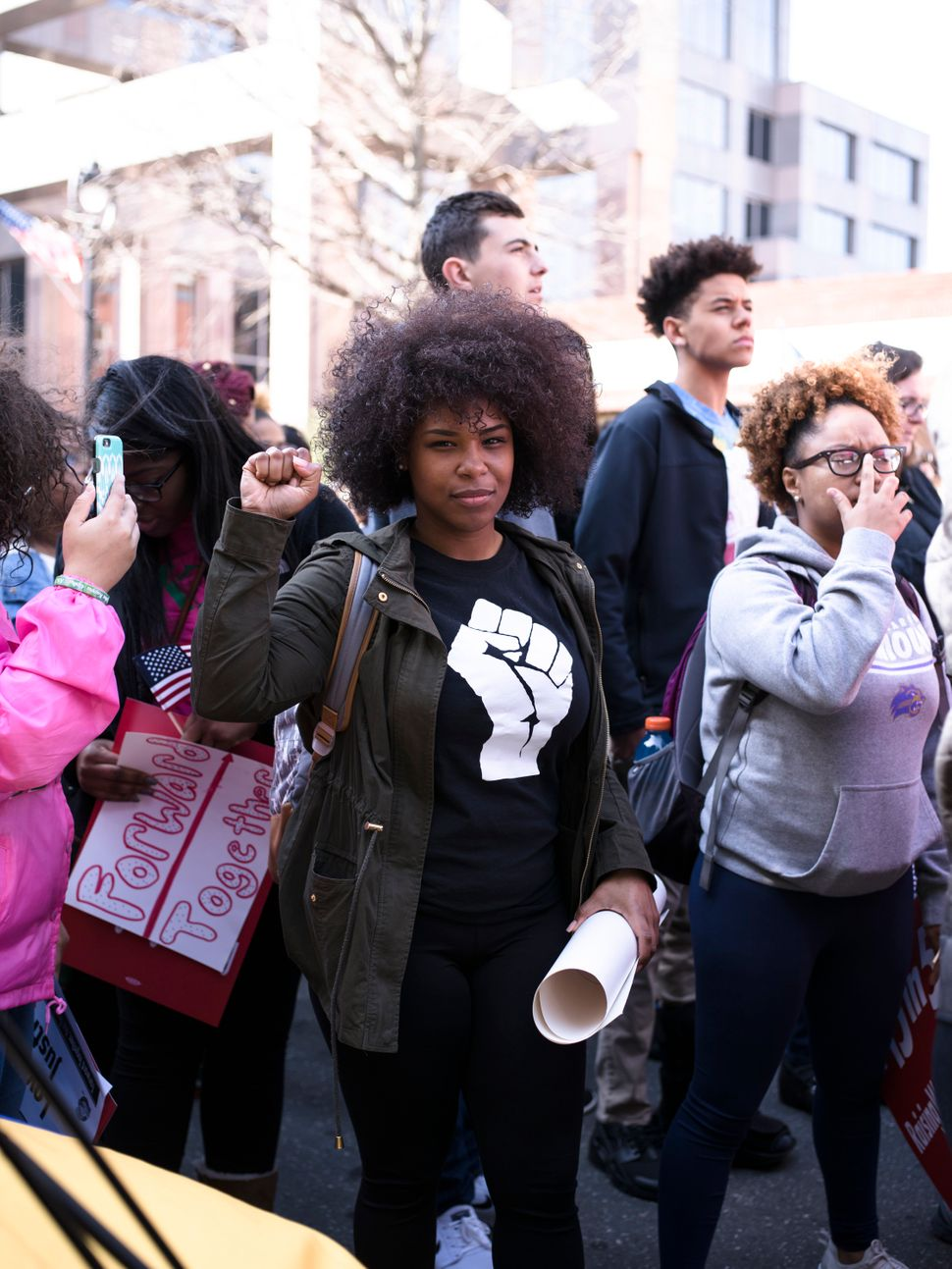 A woman holds up her fist during the Moral March on Feb 11.