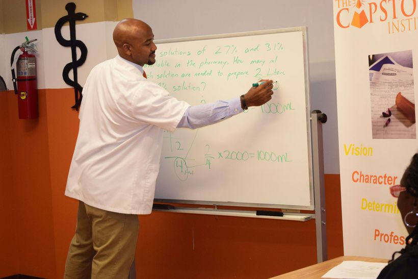 Dr. Chester teaching students.