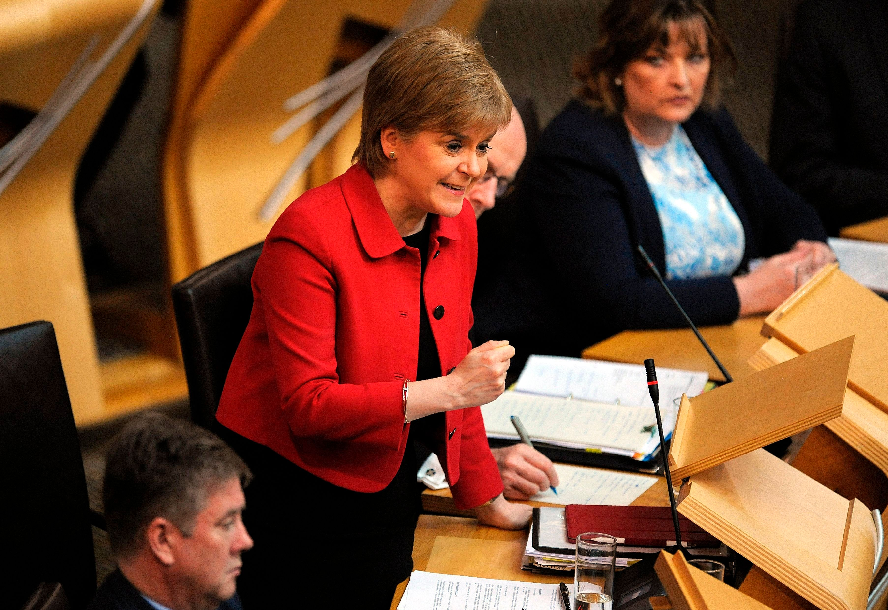 Scotland's First Minister Nicola Sturgeon speaks in the chamber  on the second day of the 'Scotland's Choice' debate on a motion to seek the authority to hold an indpendence referendum, at the Scottish Parliament in Edinburgh, on March 28, 2017. The vote in Scotland's parliament on supporting First Minister Nicola Sturgeon's call for a new independence referendum resumed Tuesday, aftering it was delayed in a gesture of respect following the March 22 attack on the British parliament. / AFP PHOTO / POOL / Andy Buchanan        (Photo credit should read ANDY BUCHANAN/AFP/Getty Images)