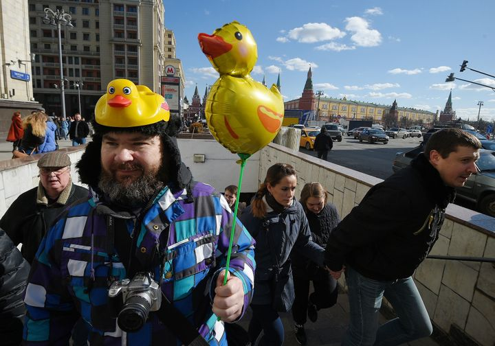 A protester holds a yellow duck toy during anti-corruption demonstrations on March 26, 2017 in Moscow.