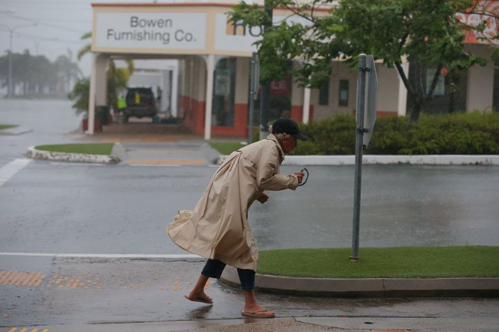 A brave local battles the wind before the worst of tropical cyclone Debbie hits in Bowen, Queensland.