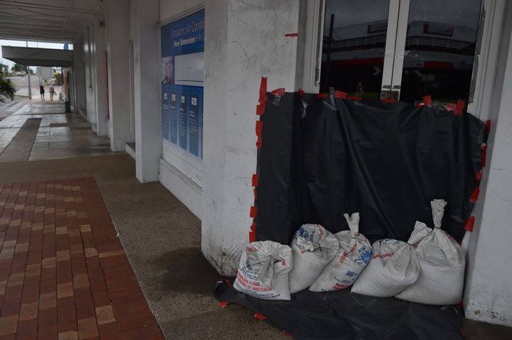 Sandbags are placed outside a business on an empty street in the town of Ayr in far north Queensland as Cyclone Debbie approa