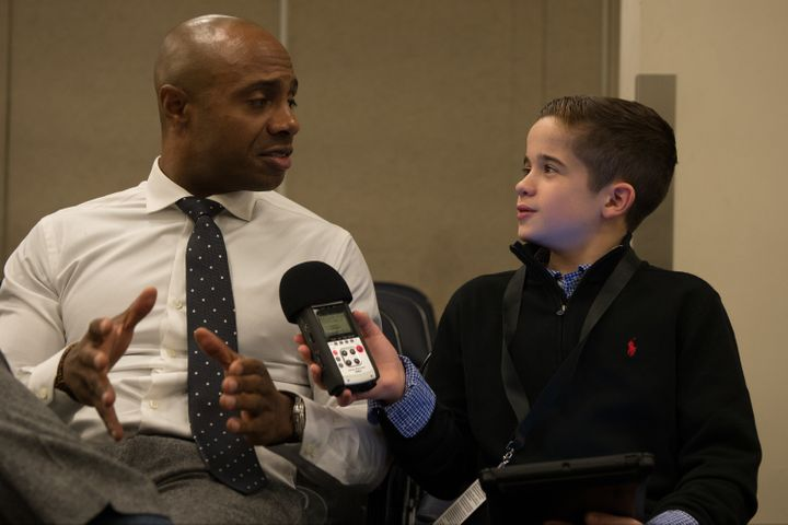 Sports Illustrated Kids reporter Max Bonnstetter at Madison Square Garden in December 2016 interviewing basketball analyst and former player Jay Williams.