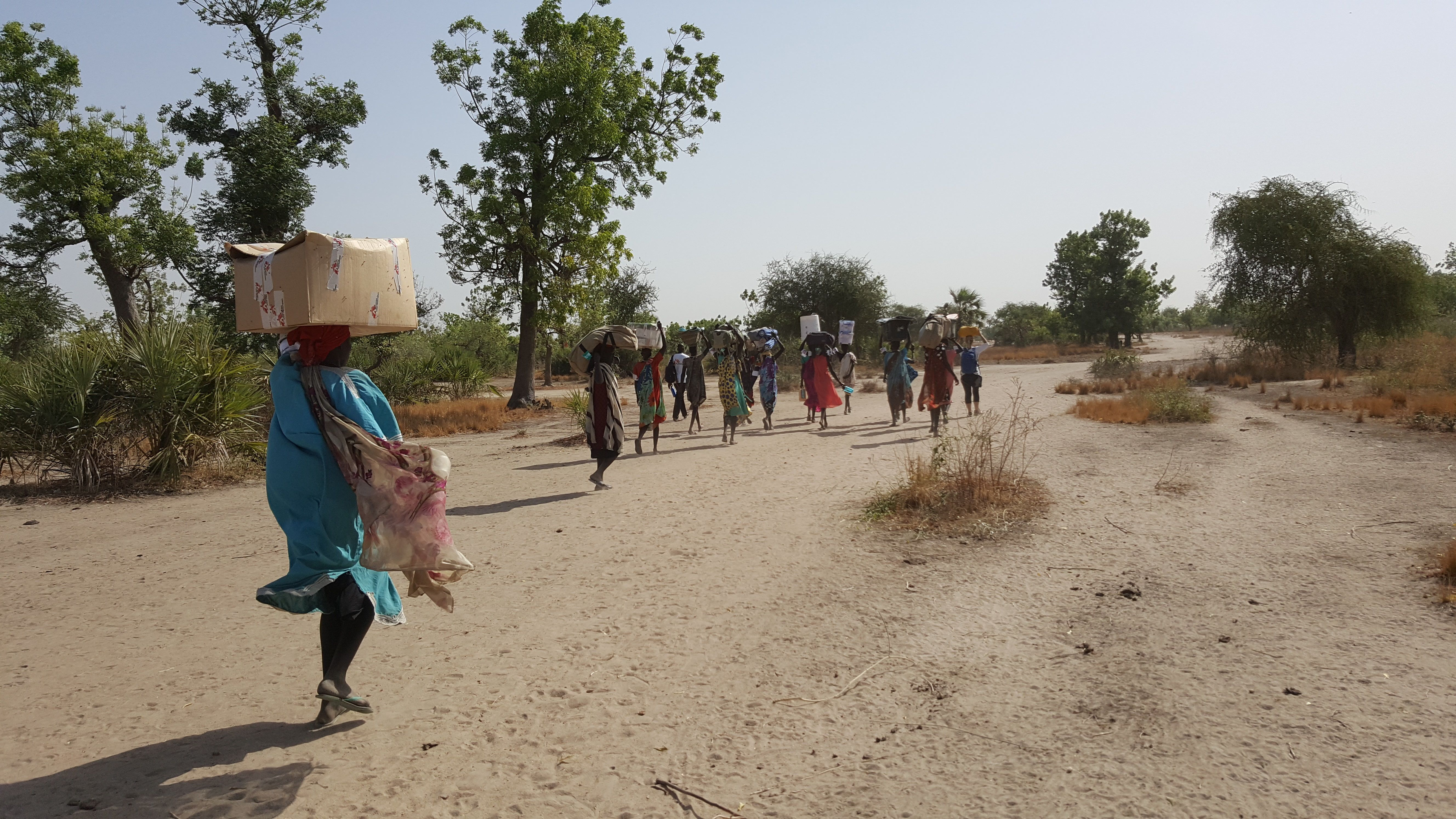 Mobile health workers in South Sudan sometimes have to walk for long hours, so they hire people from the local community to h