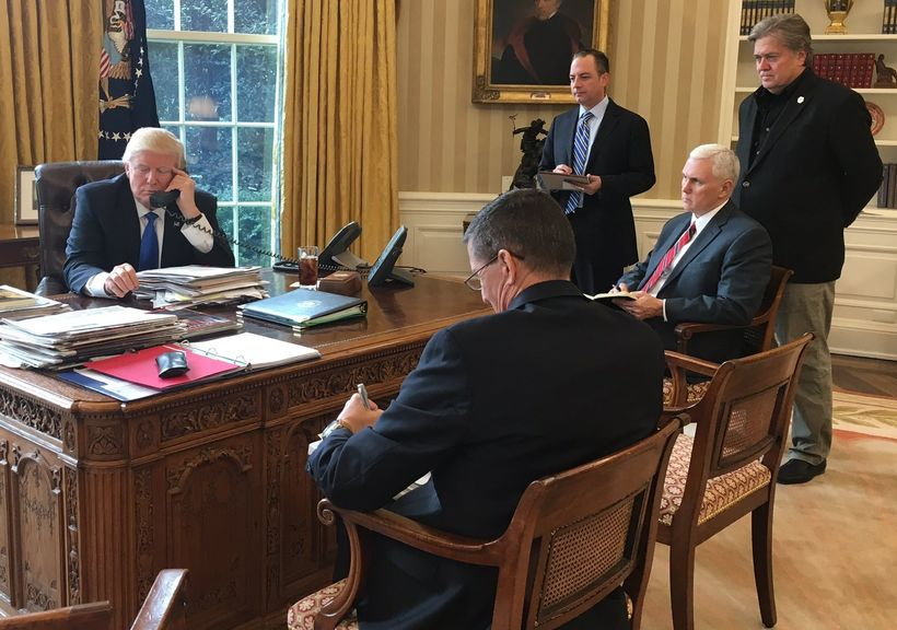 President Donald J. Trump pictured January 28, 2017 in the Oval Office as he makes a series of telephone calls to foreign gov