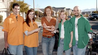 Host Paige Davis (center) of TLC's 'Trading Spaces' in which neighbors switch homes for 48 hours and redocorate a room in each other's home with help from the show's host, designers and carpenters. Davis hands over the house keys to Kirk Velazquez and Bri