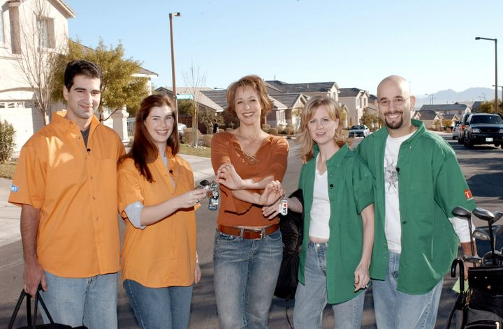 """Former """"Trading Spaces"""" host Paige Davis with two families participating on the show."""