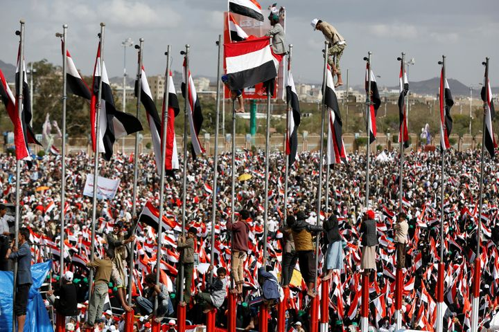 Supporters of the Houthi movement and Yemen's former president Ali Abdullah Saleh attend a rally to mark two years of the mil