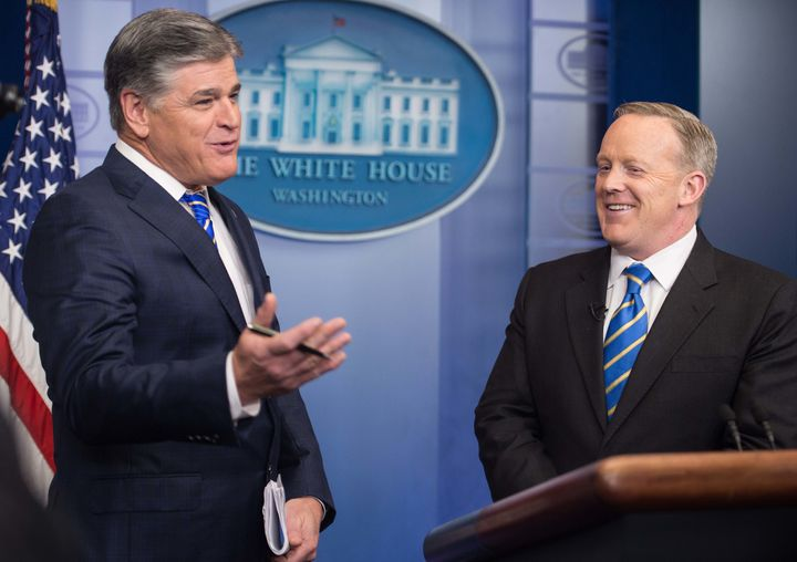 Fox News host Sean Hannity appears in the White House briefing room with Trump press secretary Sean Spicer.