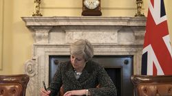 Official: This Is Theresa May Signing The Letter To Begin