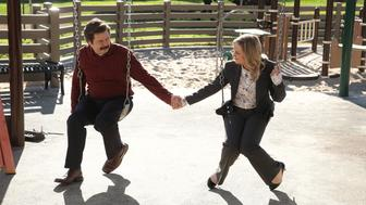 PARKS AND RECREATION -- 'One Last Ride' Episode 712/713 -- Pictured: (l-r) Nick Offerman as Ron Swanson, Amy Poehler as Leslie Knope -- (Photo by: Chris Haston/NBC/NBCU Photo Bank via Getty Images)