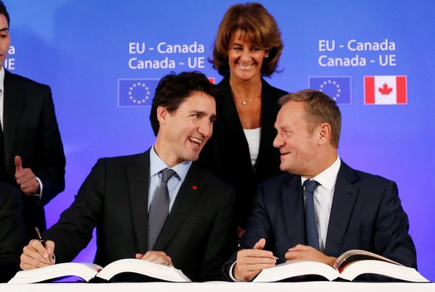 Canada's Prime Minister Justin Trudeau and European Council President Donald Tusk attend the signing...
