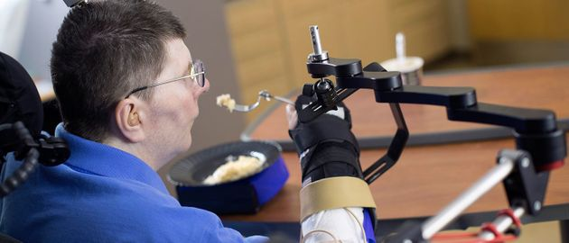 Paralysed Man Moves Arms With Thought-Control