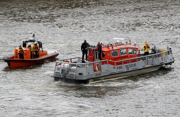 Emergency services patrol after a man fell off Westminster Bridge into the