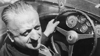 April 1964:  Enzo Ferrari (1898 - 1988), the Italian car designer, behind the wheel of one of his cars.  (Photo by Evening Standard/Getty Images)