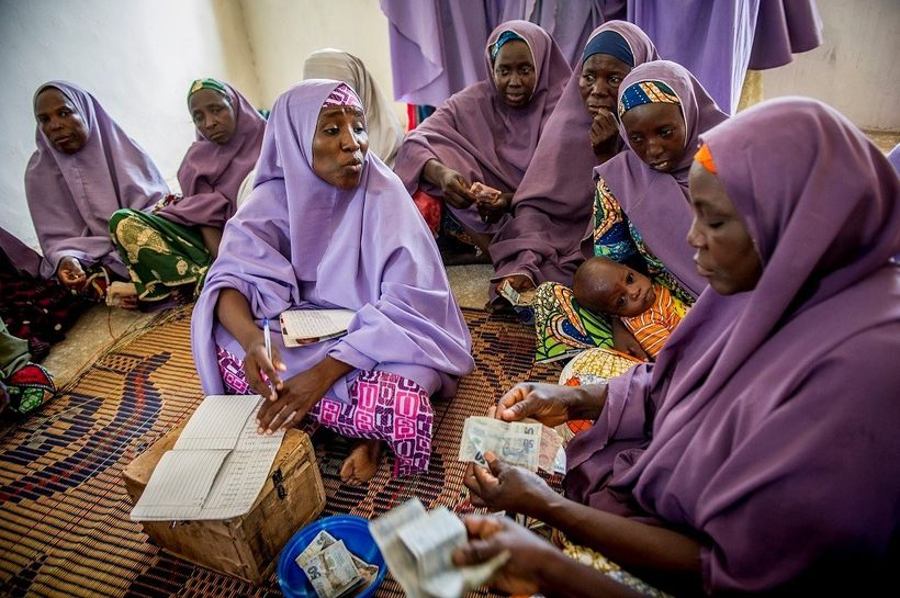 Members of the Mada Saving Club for women in Nigeria contribute money weekly for members to borrow when they need it.