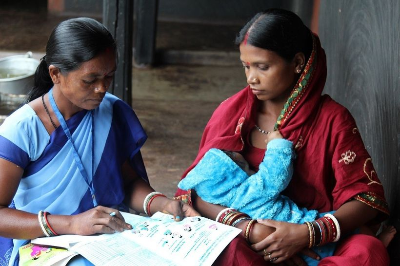 <em>An accredited Social Health Activist in northeastern India discusses the importance of exclusive breastfeeding in the fir