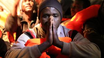 A migrant reacts aboard the former fishing trawler Golfo Azzurro of the Spanish NGO Proactiva Open Arms after a rescue operation of 104 sub-Saharan migrants aboard an overcrowded raft, in the central Mediterranean Sea, 24 miles north of the Libyan coastal city of Sabratha, January 27, 2017. REUTERS/Giorgos Moutafis