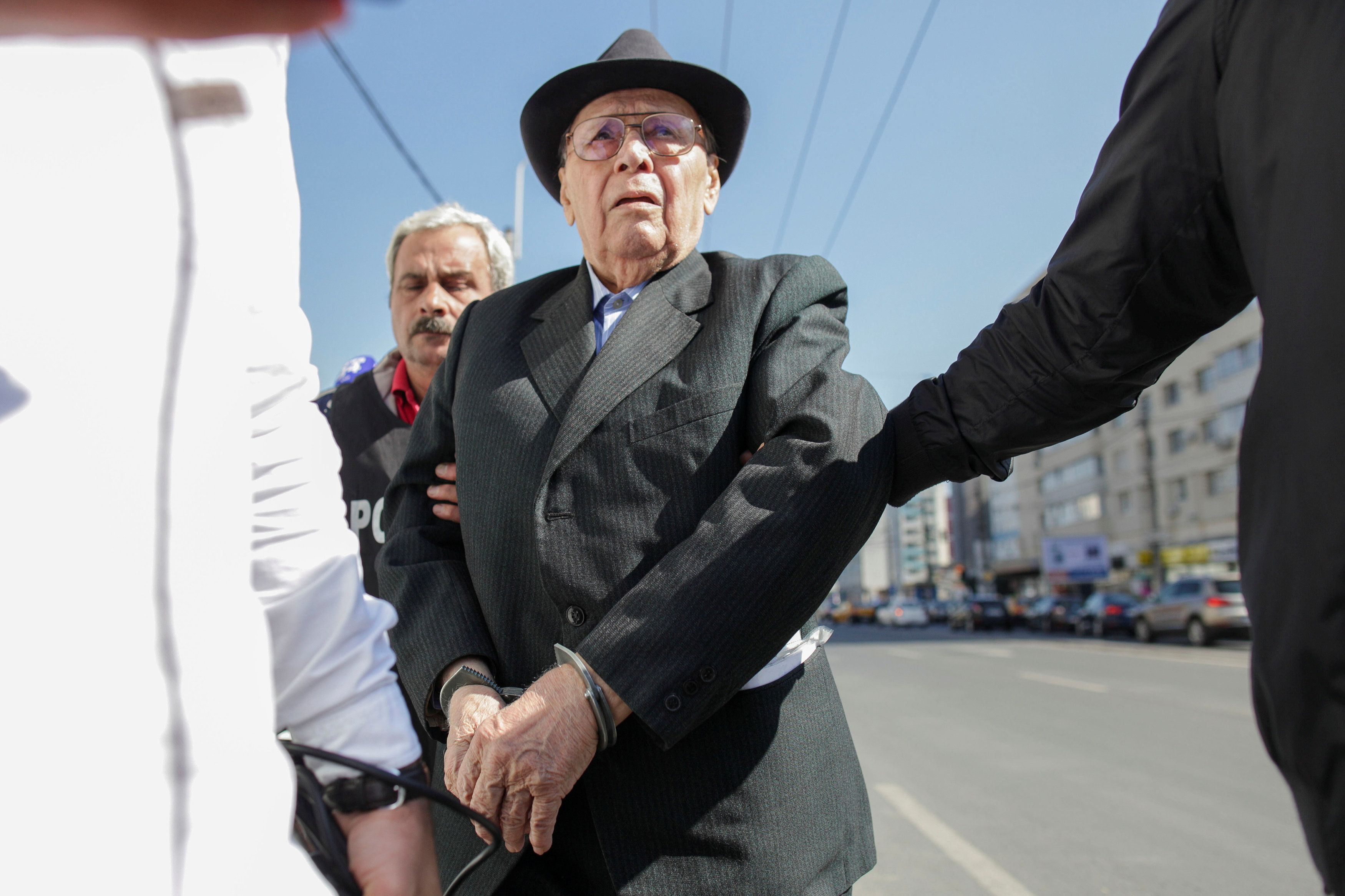 Ioan Ficior, 89, a Romanian communist-era labour prison commander is escorted by police at the end of his trial in Bucharest, Romania, March 29, 2017. Inquam Photos/Liviu Florin Albei via REUTERS ATTENTION EDITORS - THIS IMAGE WAS PROVIDED BY A THIRD PARTY. EDITORIAL USE ONLY. ROMANIA OUT. NO COMMERCIAL OR EDITORIAL SALES IN ROMANIA.