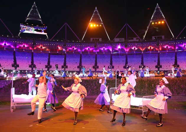 Nurses representing the NHS take part in the Opening Ceremony of the London 2012 Olympic