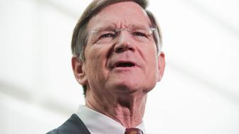 UNITED STATES - MARCH 20:  Rep. Lamar Smith, R-Texas, conducts a news conference where he and republican leaders discussed the new budget proposal by House Budget Committee Chairman Paul Ryan, R-Wisc., after a meeting of the House Republican Caucus in the Capitol. (Photo By Tom Williams/CQ Roll Call)