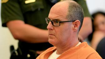 Scott Dekraai (L), accused of killing eight people in a Seal Beach beauty salon in 2011, listens to the judge during a motions hearing in Santa Ana March 18, 2014. The hearing is underway to address the public defender's allegations of a widespread, unconstitutional jailhouse informant program that he feels affects the case of his defendant.   REUTERS/Mark Boster/Los Angeles Times/Pool   (UNITED STATES - Tags: CRIME LAW)
