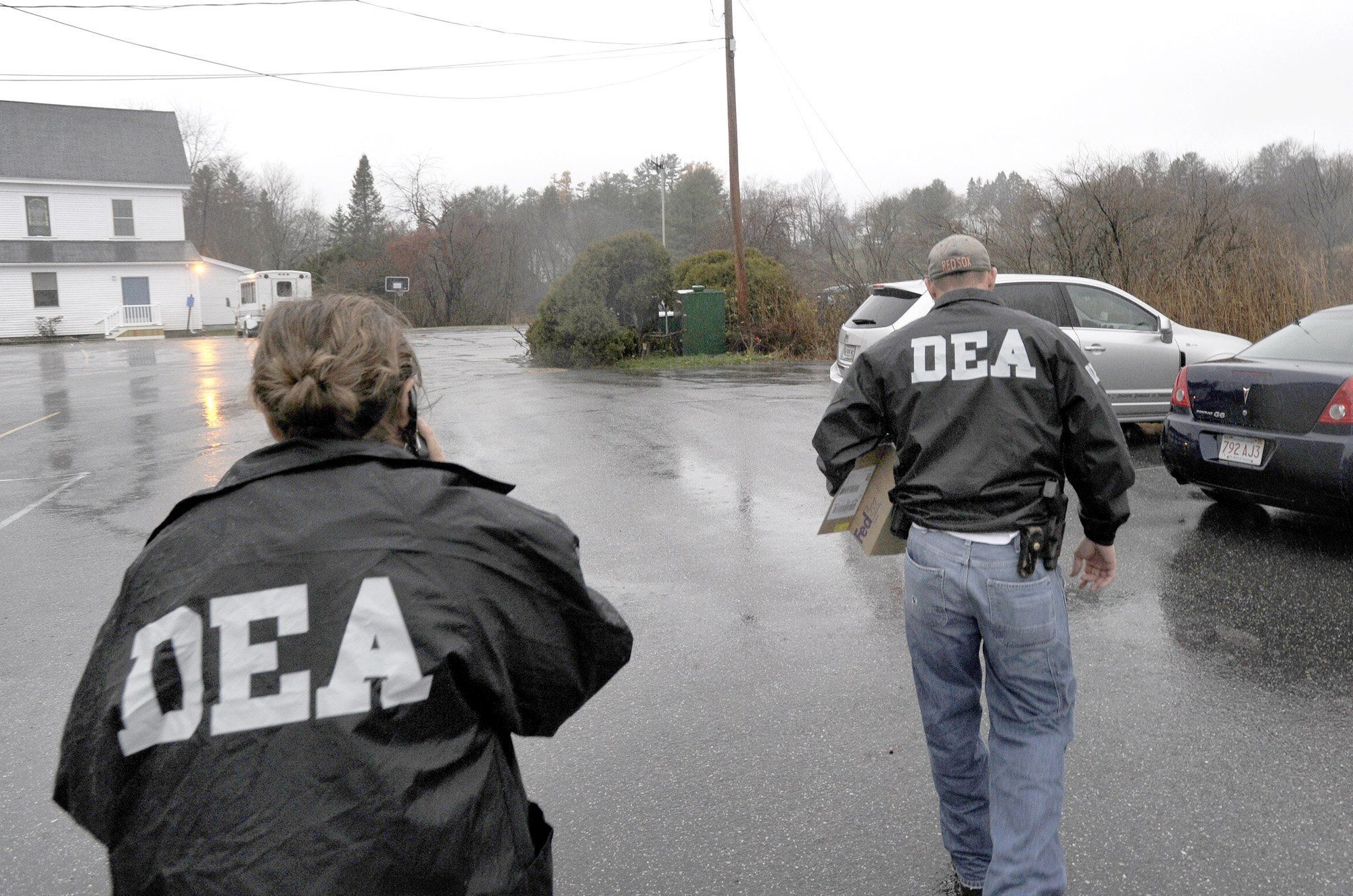 John Patriquin /Staff Photographer; Wed., 11/17/10. DEA agents leave the offices of Dr. John Perry at Atlantic Foot & Ankle Center at 1711 Congress st. in Portland this morning carrying small boxes. (Photo by John Patriquin/Portland Press Herald via Getty Images)