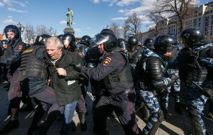Law enforcement officers detain an opposition supporter during a rally in Moscow, Russia, March 26, 2017.