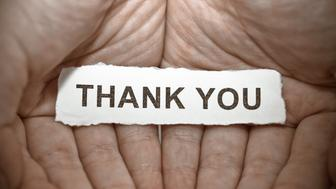 'Thank you' text on hand
