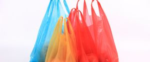 MERCHANDISE NO PEOPLE GROUP OF OBJECTS SINGLE OBJECT SHOPPING MULTI COLORED WHITE RED BLUE PLASTIC CLOSEUP BAG ISOLATED