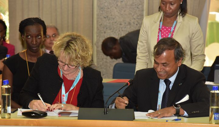 <em>The Ambassador of Denmark to Kenya, H.E. Mette Knudsen and the UN Resident Coordinator, Siddharth Chatterjee signing the