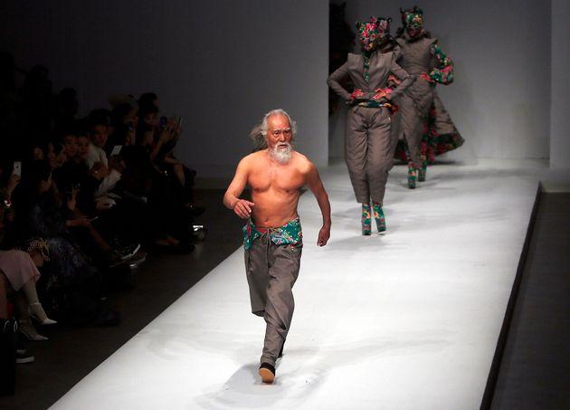 Wang Deshun walks the runway during the Sheguang Hu show as part of Mercedes-Benz China Fashion Week...