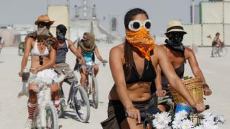 "Participants wear face masks and goggles to protect themselves during a dust storm in the midst of the Burning Man ""Rites of Passage"" arts and music festival in the Black Rock Desert of Nevada, August 31, 2011. More than 50,000 people from all over the world have gathered at the 25th edition of the sold-out festival. REUTERS/Jim Bourg (UNITED STATES - Tags: SOCIETY ENTERTAINMENT) FOR USE WITH BURNING MAN RELATED REPORTING ONLY. FOR EDITORIAL USE ONLY. NOT FOR SALE FOR MARKETING OR ADVERTISING CAMPAIGNS. NO THIRD PARTY SALES. NOT FOR USE BY REUTERS THIRD PARTY DISTRIBUTORS"