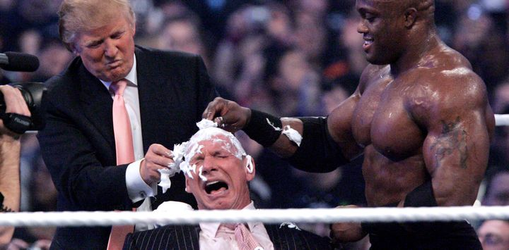 Donald Trump and WWE wrestler Bobby Lashley shave the head of CEO Vince McMahon during Wrestlemania 23 in 2007.