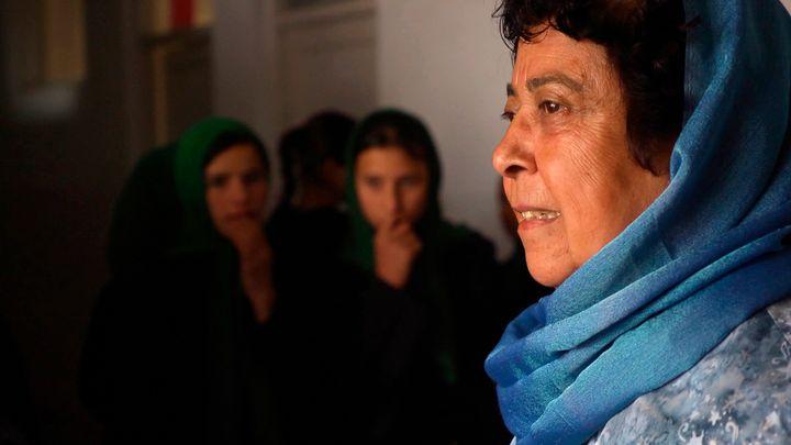 <em>Razia Jan greets students at the Zabuli Education Center, a K-12 girls' school in Afghanistan. </em>