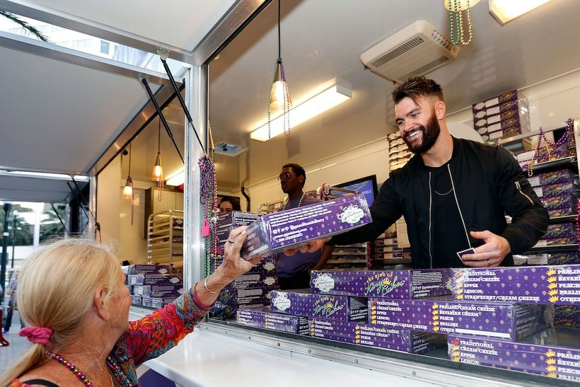 Country music artist Dylan Scott helps Crown Royal inspire generosity by passing out king cakes in exchange for Mardi Gras be