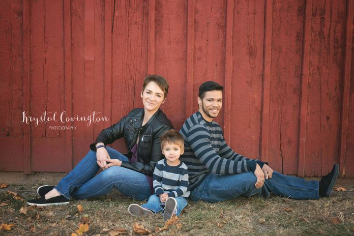 Victoria Baldwin, Adam Dyson and their son Bruce pose for a family portrait.