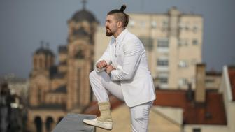 """Student and 2017 presidential candidate Luka Maksimovic, 25, poses for a picture as his alter ego 'Ljubisa """"Beli"""" Preletacevic' a parody of the worst politician in the Balkans,in Belgrade, Serbia, March 14, 2017. Picture taken March 14. REUTERS/Marko Djurica"""