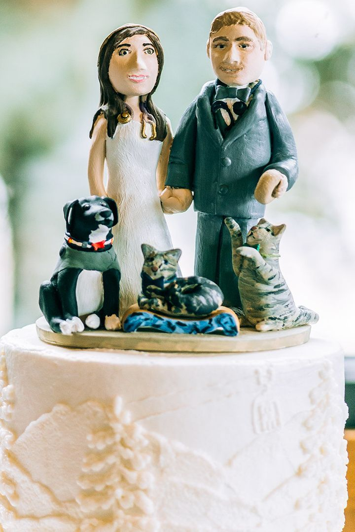 The cake topper featured the couple, their two cats and dog.