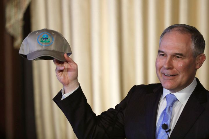 Environmental Protection Agency Administrator Scott Pruitt holds up an an agency baseball hat as he addresses employees at th