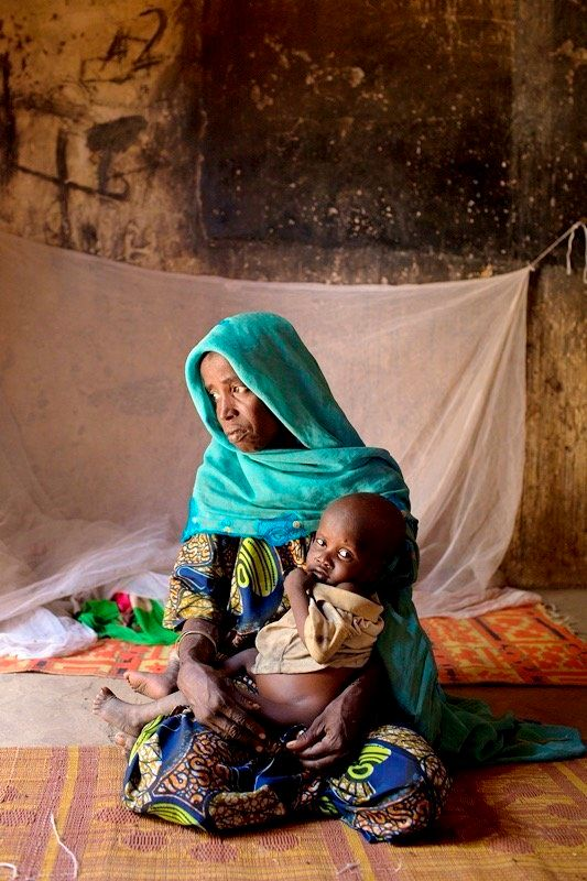 Izah fled to Monguno after a Boko Haram attack and is now a widow raising seven children alone.