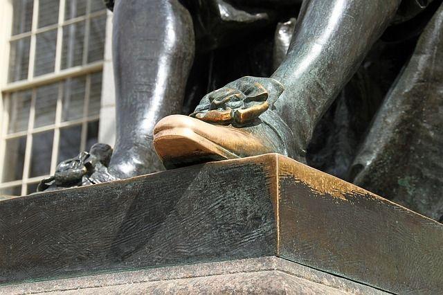 The foot of John Harvard.