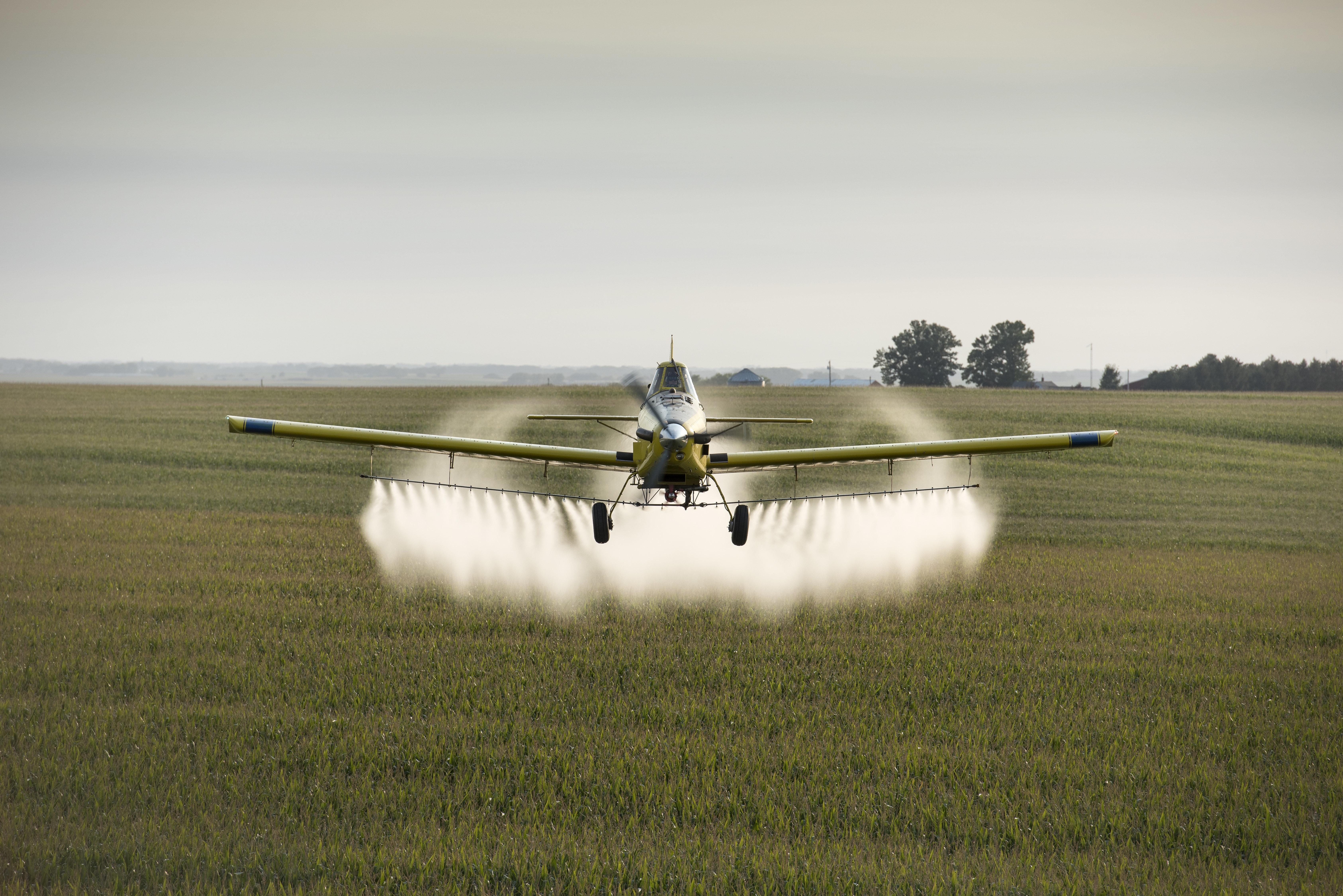 A pilot sprays crops near Whittemore, Iowa.