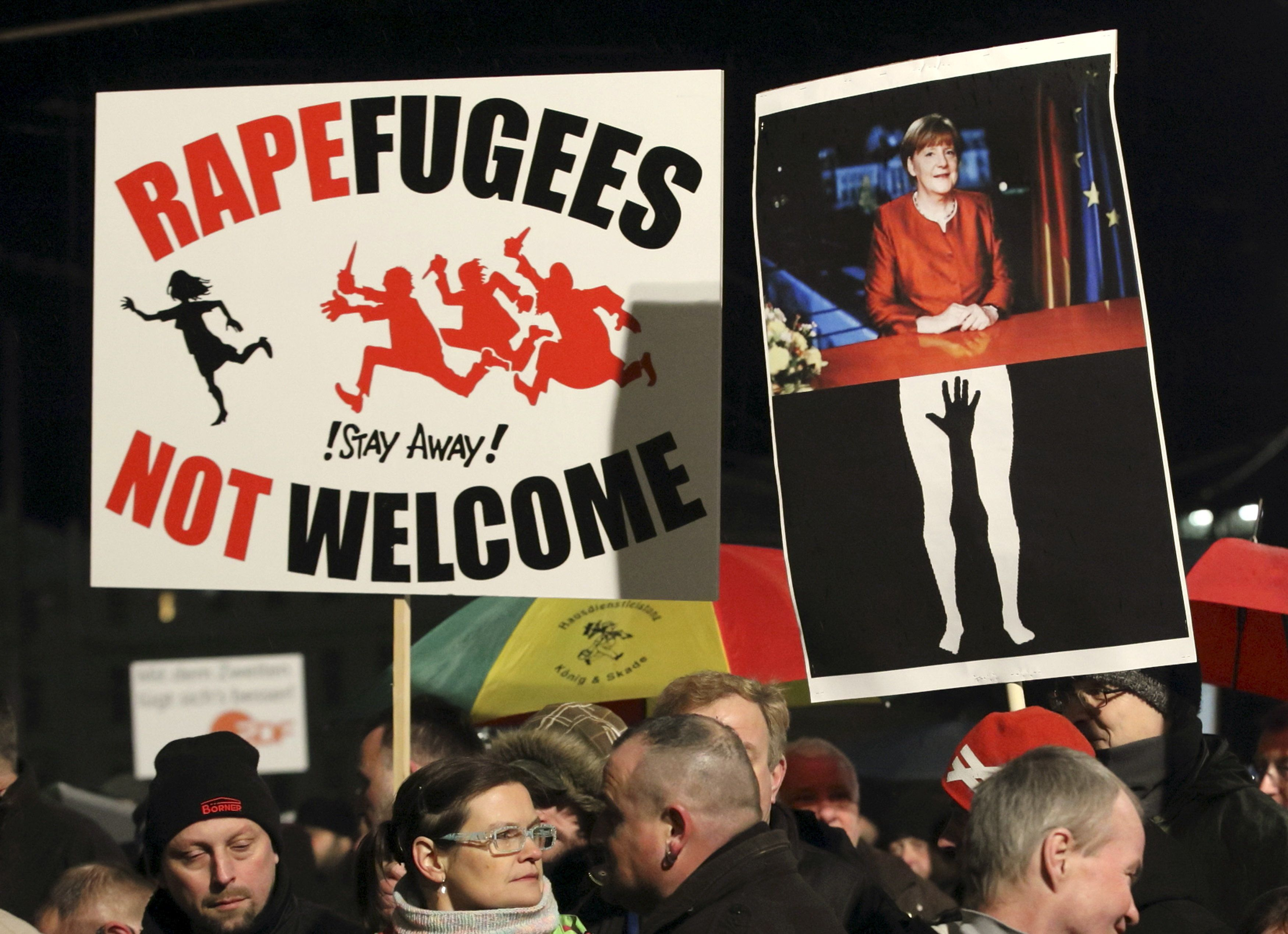 Members of LEGIDA, the Leipzig arm of the anti-Islam movement Patriotic Europeans Against the Islamisation of the West (PEGIDA), hold a placard showing German Chancellor Angela Merkel (R) as they take part in a rally in Leipzig, Germany, January 11, 2016. REUTERS/Fabrizio Bensch TEMPLATE OUT