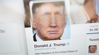 Fake Donald Trump tweets are seen in a Twitter timeline on 27 Friday, 2017. In China a site that generates fake tweets that look as if they were generated by US president Donald Trump are geing used to mock the president. (Photo by Jaap Arriens/NurPhoto via Getty Images)