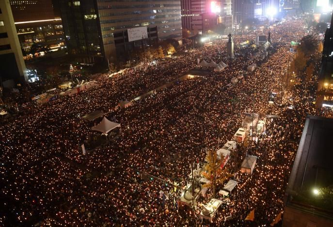 Protesters hold candles ... not on a march on Washington, D.C. but rather on central Seoul on November 18, 2016, aimed at for