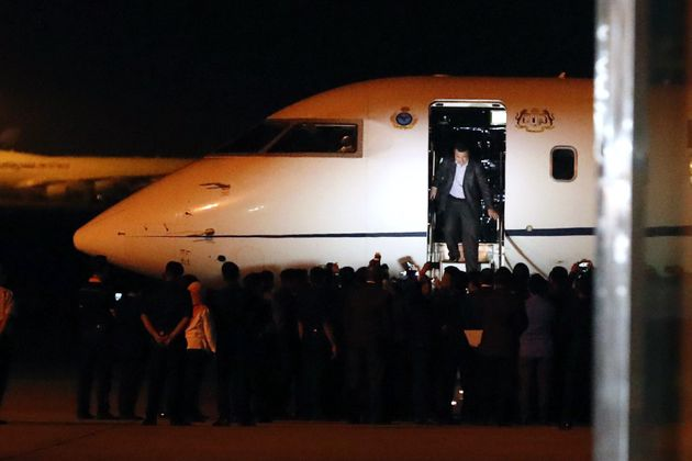 One of the Malaysians stranded in Pyongyang walks down from a plane after arriving at Kuala Lumpur on