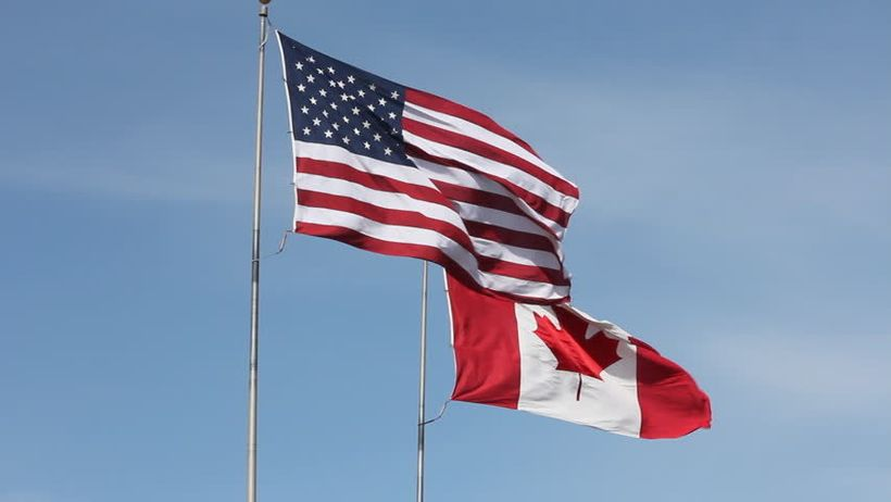 Flags of the United States and Canada.