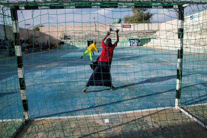 Two young women warm up before the finals of the Somali Women's Handball Tournament in Mogadishu, in November 2016.